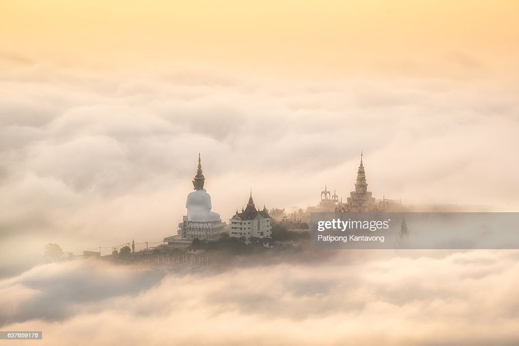 morning view point with mountain mist and Big Buddha statue in thailand