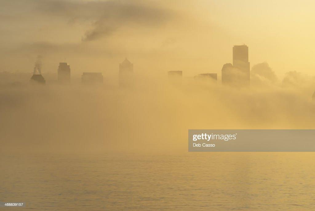 Fog over city skyline : Stock Photo