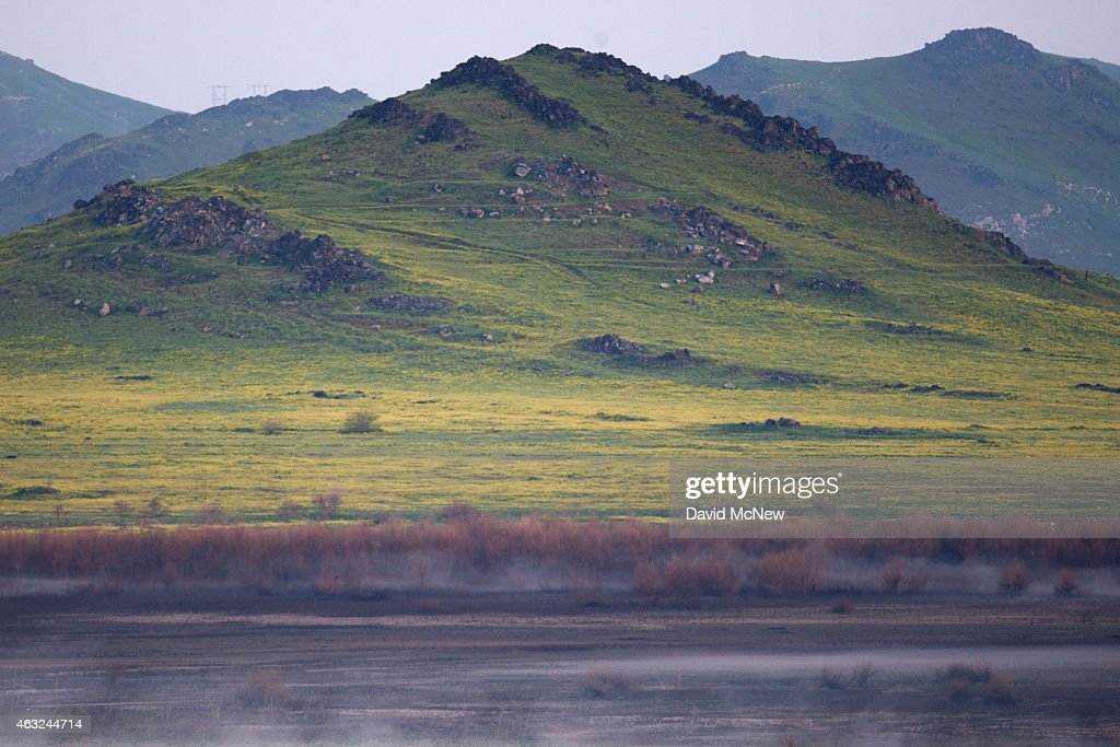 Fog rise from a dry section of Lake Success as rain totals remain insufficient to break the worsening drought on February 11 2015 near East...