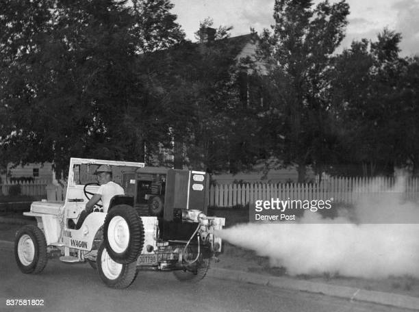 A fogging machine moves down an Alamosa Colo street dealing death to mosquitoes Earl Jordan is the driver Over a fifteenyear period Alamosa Junior...