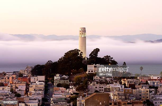 Foggy cityscape overview of Coit Tower in San Francisco