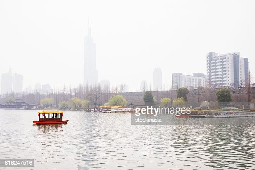 Foggy scene of a boat in the lake : Stock Photo