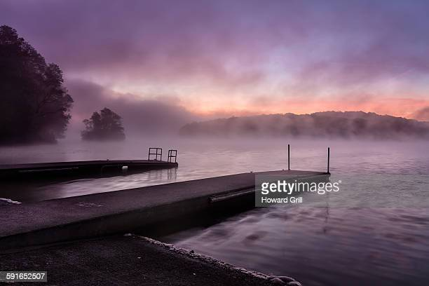 Foggy sunrise at boat launch
