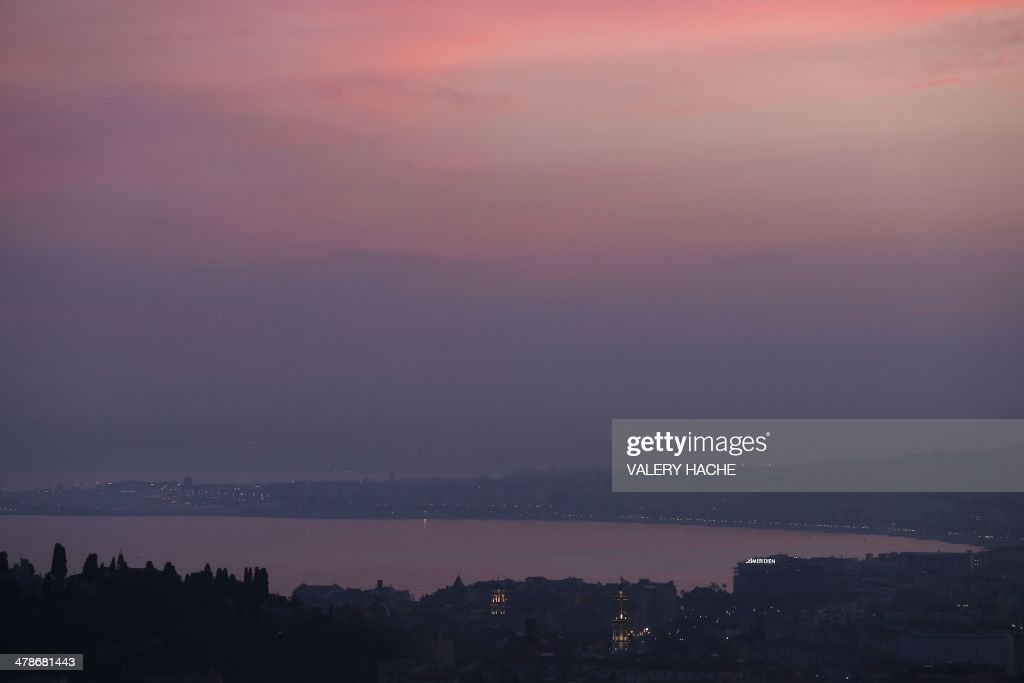 A foggy view of the bay of Nice, known as 'Baie des Anges' on March 14, 2014 in Nice, southeastern France. Over 30 departments in France have exceeded the maximum warning threshold for particulate pollution, prompting the French Ecology Minister to say that the air quality was 'an emergency and a priority for the government.' AFP PHOTO / VALERY HACHE