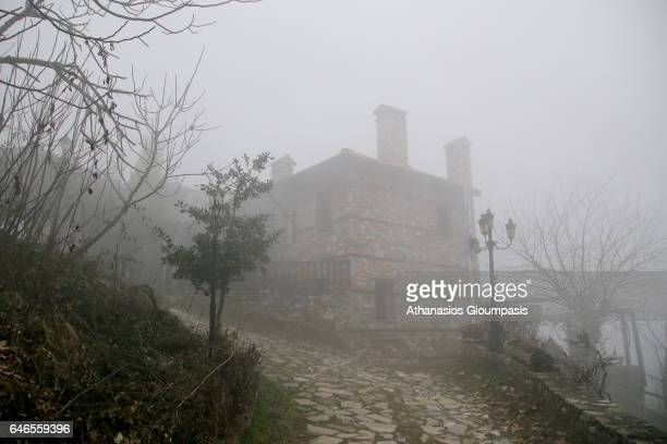 Foggy view of the Village Palaios Panteleimonas on February 27 2017 in Olympus National Park GreecePalios Panteleimonas is a mountain villageΤhe view...