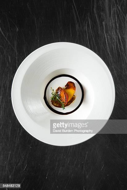 Foie gras on white plate