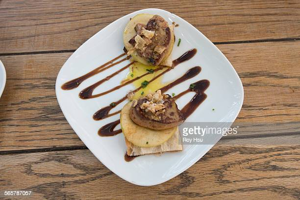 Foie Gras with sliced apple on bread