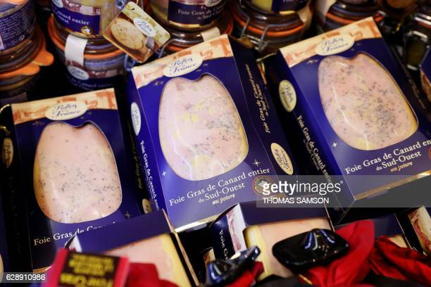 Foies gras trays are pictured in an hypermarket store of French retail giant Carrefour in Villeneuvelagarenne near Paris on December 7 2016 / AFP /...