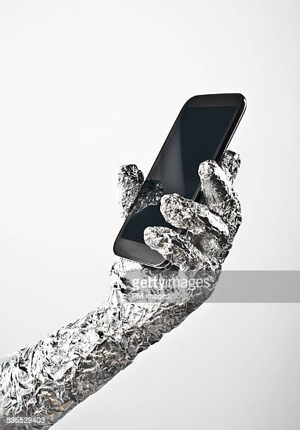 Foil Wrapped Hand And Smartphone