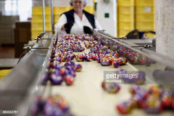 Foilwrapped Cadbury Creme Eggs move along the production line at the Bournville Cadbury factory operated by Mondelez International Inc in Birmingham...