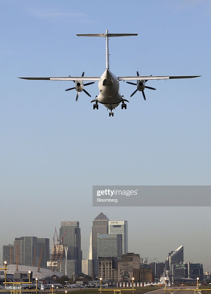 A Fokker 50 aircraft, operated by CityJet Ltd., prepares to land at City Airport against a backdrop of the Canary Wharf financial district in London, U.K., on Tuesday, Dec. 4, 2012. Air France-KLM Group's CityJet unit is studying options for a new investor, with a trade buyer a possibility given its strength at London City airport, Chief Executive Officer Christine Ourmieres said in an interview. Photographer: Chris Ratcliffe/Bloomberg via Getty Images