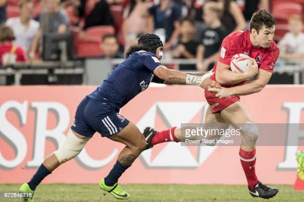 Folau Niua of USA tries to tackle Matt Mullins of Canada who runs with the ball during the match United States vs Canada the Cup Final of the HSBC...
