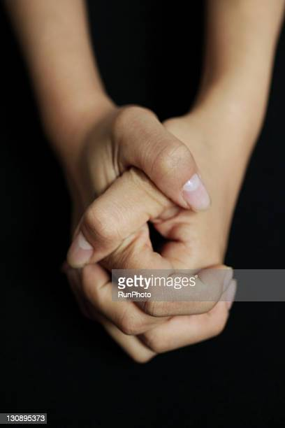 folded hands,hands close-up