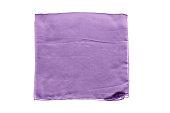 Folded purple silk kerchief isolated over white