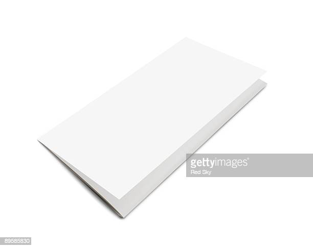 folded piece of paper on a white background