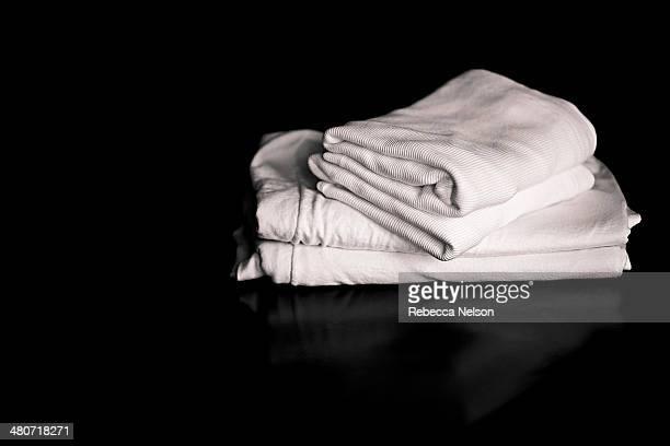 folded white tee shirts