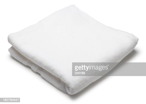 Folded white terrycloth towel on white background