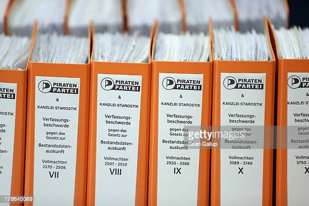 Folder containing the powers of attorney of over 6000 people who are participating in a class action suit led by the German Pirates Party to change a...
