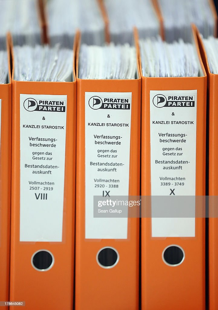 Folder containing the powers of attorney of over 6,000 people who are participating in a class action suit led by the German Pirates Party (Die Piraten) to change a law that allows German law enforcement agencies to tap into electronic communications (Bestandsdatenauskunft) lie on a table at the Pirates' local election campaign headquarters on August 30, 2013 in Berlin, Germany. The Pirates party are leading the suit in part due to public reaction over the current NSA surveillance scandal. Germany is scheduled to hold elections on September 22 and the Pirates, who last year rode a wave of popularity that won them seats in several state parliaments, have since faltered and are unlikely to win the 5% minimum needed to gain seats in the Bundestag.