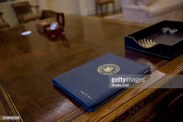 A folder for President Bush on his desk in the Oval Office when empty The Oval Office is the official office of the President of the United States...