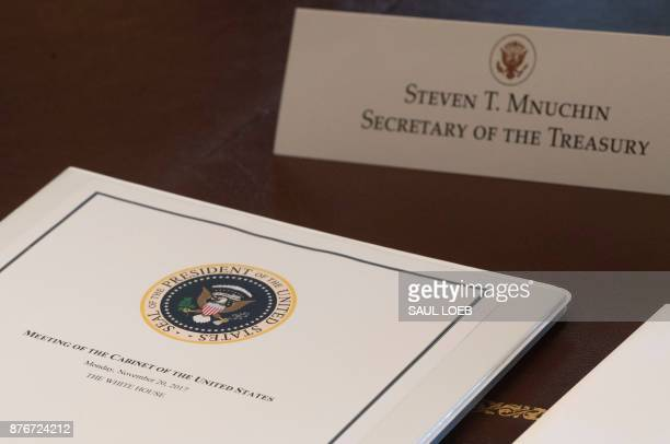 A folder for Treasury Secretary Steven Mnuchin sits on the table as US President Donald Trump holds a Cabinet Meeting in the Cabinet Room of the...