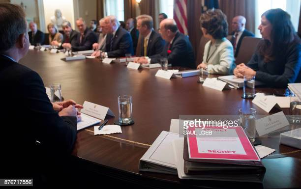 A folder marked 'Secret' sits on the table as US President Donald Trump holds a Cabinet Meeting in the Cabinet Room of the White House in Washington...