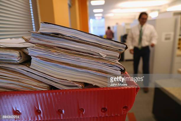 Folders with immigrants' applications for permanent US residency await processing in the US Citizenship and Immigration Services Dallas Field Office...