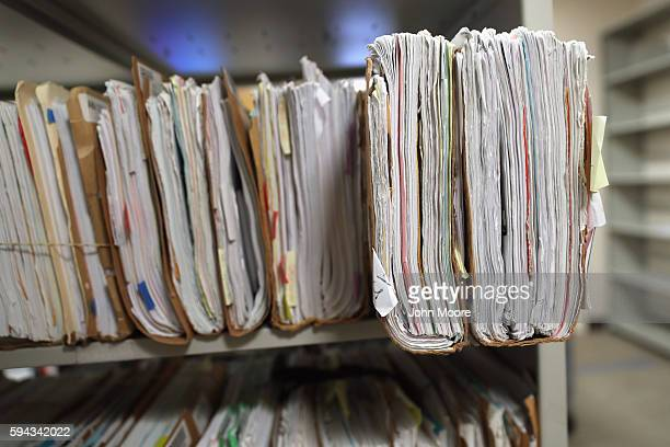 Folders with immigrants' applications for permanent US residency sit stacked in the US Citizenship and Immigration Services Dallas Field Office on...