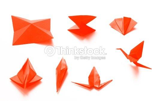 Folding An Origami Crane Stock Photo Thinkstock
