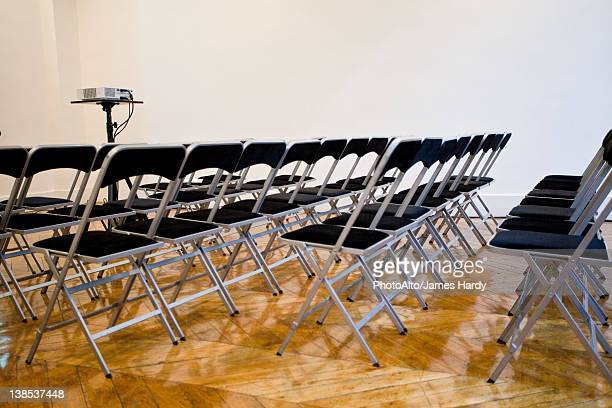 Folding chairs lined up in conference room