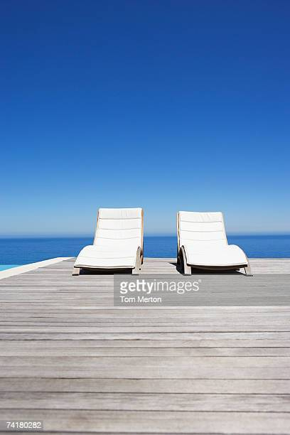 Folding chairs on infinity pool deck