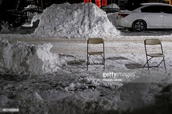 Folding chairs used as space savers in the South End of Boston Mass Jan 28 2015