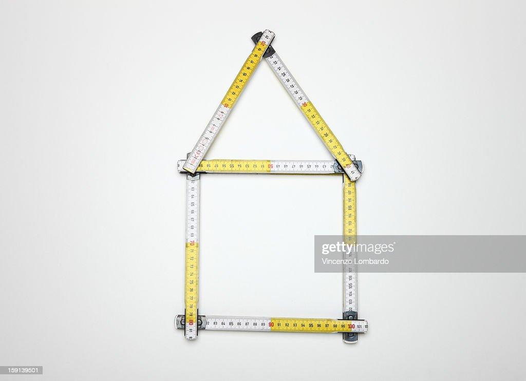 Folding ruler forming a house shape : Stock Photo
