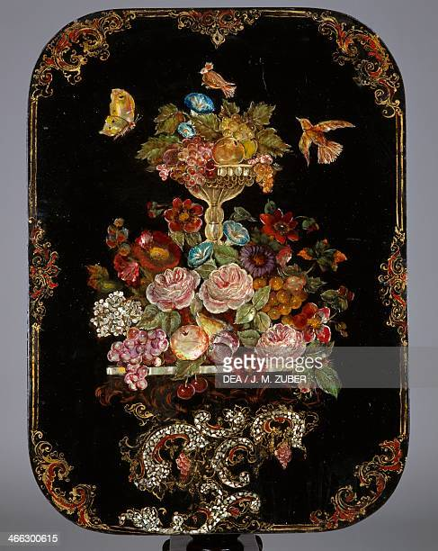 Folding top of a Second Empire style blackened wood and papier mache with black lacquer finish folding tabel inlaid with mother of pearl 18501875...