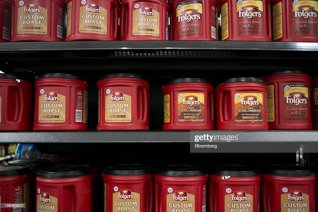 Folgers Coffee Co. coffee sits on display at a Wal-Mart store in Alexandria, Virginia, U.S., on Wednesday, Nov. 14, 2012. Wal-Mart Stores Inc. is scheduled to release earnings data on Nov. 15. Photographer: Andrew Harrer/Bloomberg via Getty Images