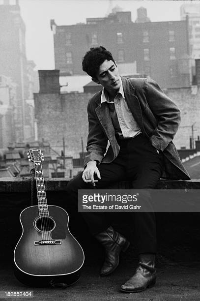 Folk and bluegrass musician and singer songwriter John Herald poses for a portrait in October 1963 on a Greenwich Village rooftop in New York City...