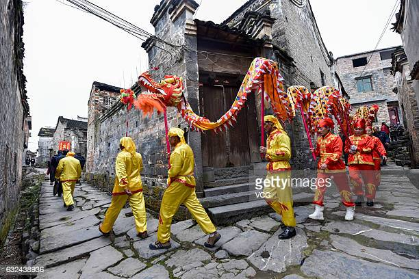 Folk artists perform dragon dance at Miaoxiagu Village on January 21 2017 in Chenzhou Hunan Province of China Chinese people perform dragon dance...