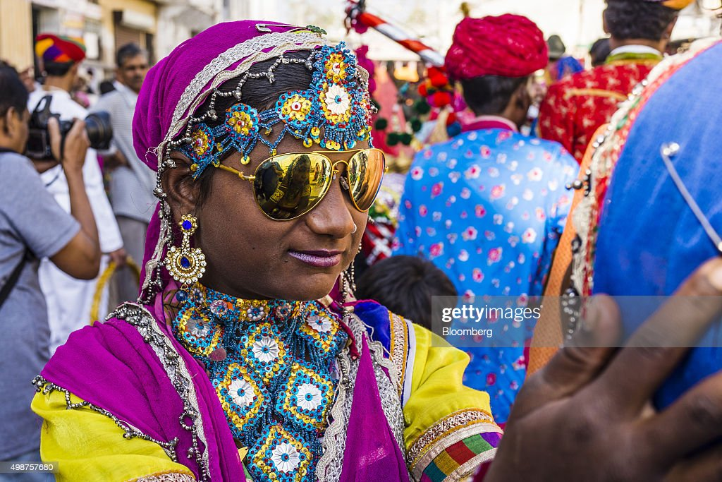 Folk dancers participate in a procession, showcasing artists and children dressed as various Gods and Godesses, through a street during the Pushkar Camel Fair in Pushkar, Rajasthan, India, on Sunday, Nov. 22, 2015. Throw together hundreds of thousands of rural Indians, colorful festivals and throngs of tourists and you get the annual Pushkar Fair. Photographer: Prashanth Vishwanathan/Bloomberg via Getty Images
