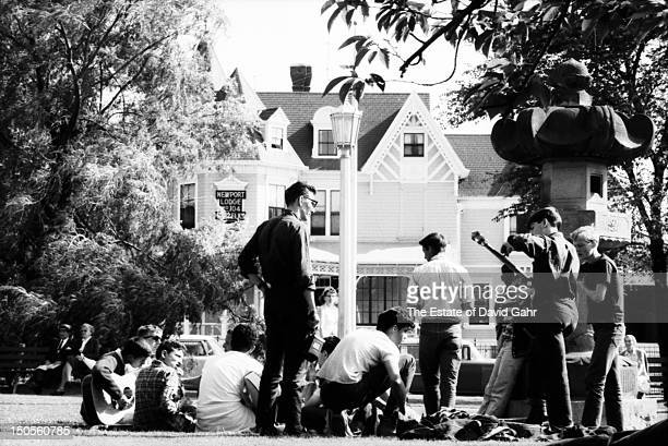 Folk fans and musicians gather for an impromptu hootenanny before the opening of the Newport Folk Festival in July 1960 in Newport Rhode Island
