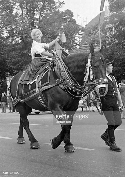 folk festival Munich Beer Festival 1966 Entry of the Oktoberfest Staff and Breweries traditional costume parade a coachman leads a coach horse aged...