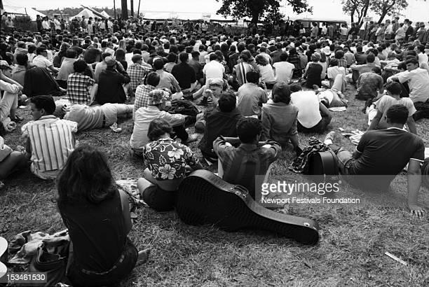 Folk music audience attend afternoon folk music workshops at the Newport Folk Festival in July 1965 in Newport Rhode Island