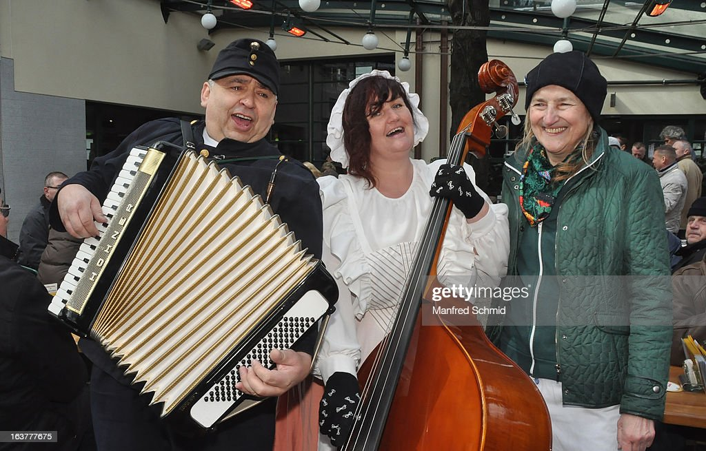 A folk music band and Lydia Kolarik (R) during the opening of Schweizerhaus Wien on March 15, 2013 in Vienna, Austria.