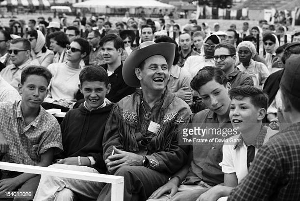 Folk musician and songwriter Jimmy Driftwood in the audience at the Newport Folk Festival in July 1959 in Newport Rhode Island Jimmy Driftwood is the...
