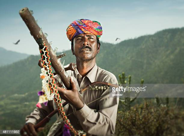 Folk musician of Rajasthan, India playing traditional musical instrument Ravanahatha.