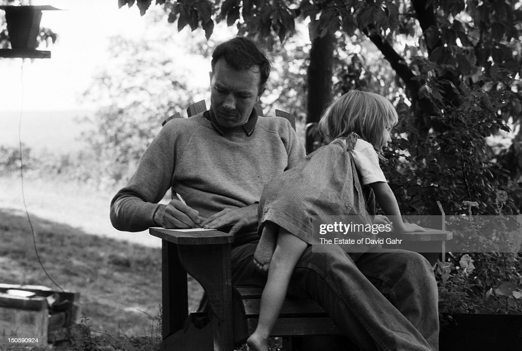 Folk musician Pete Seeger and his daughter Tinya Seeger are photographed on a relaxed afternoon in September, 1958 at the Seeger's log cabin home in Beacon, New York.