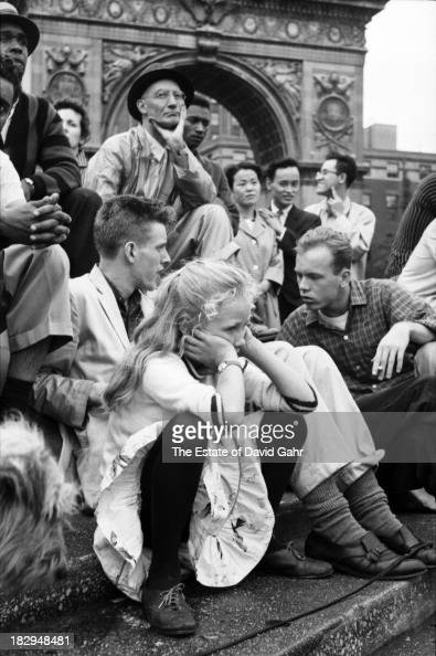 Folk musicians and folk music enthusiasts gather in August 1958 in Greenwich Village's Washington Square Park in New York City New York