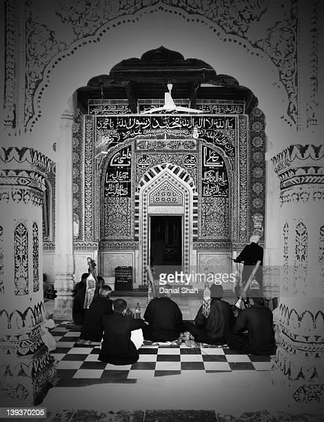 Folk musicians playing sitar at shrine