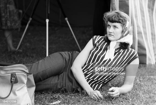 Folk singer and folk song collector Peggy Seeger backstage at the Newport Folk Festival in July 1959 in Newport Rhode Island Ms Seeger is the...