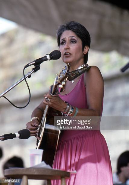 Folk singer and musician Joan Baez performs at the Newport Folk Festival in August 1985 in Newport Rhode Island