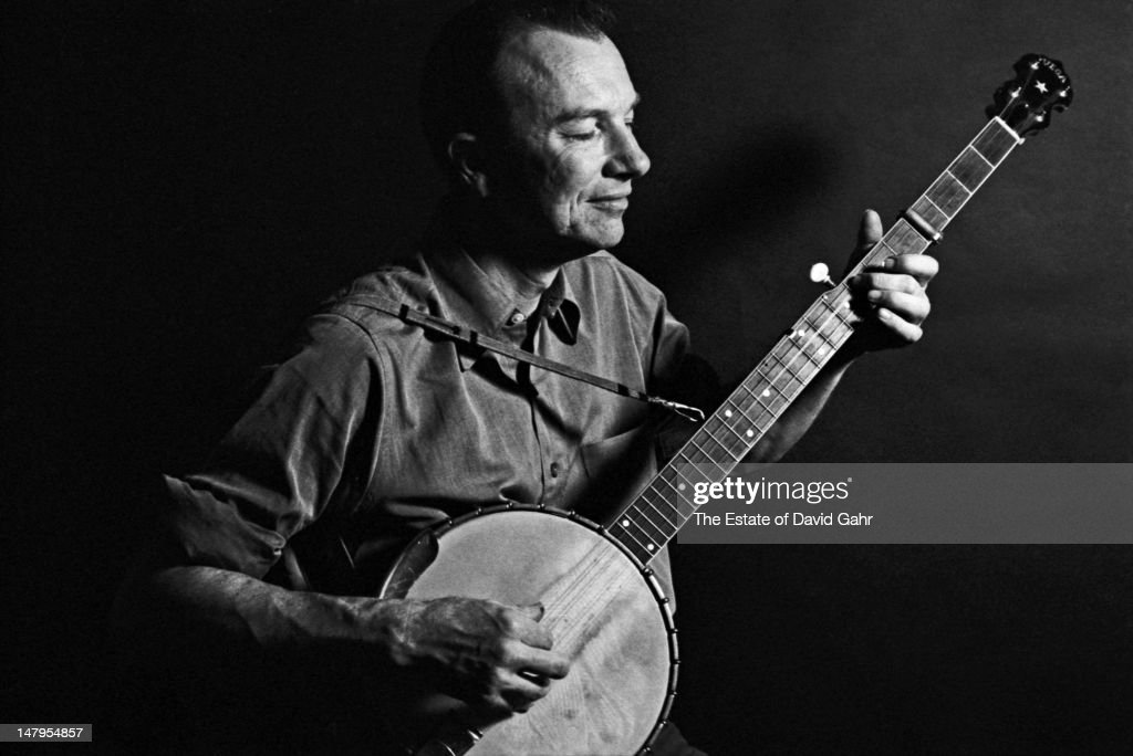Folk singer and musician, songwriter, and environmental activist <a gi-track='captionPersonalityLinkClicked' href=/galleries/search?phrase=Pete+Seeger&family=editorial&specificpeople=213821 ng-click='$event.stopPropagation()'>Pete Seeger</a> poses for a portrait with his banjo in April 1962 in New York City, New York.